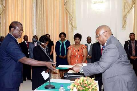 Acting President Ngosa Simbyakula receives an affidavit of Oath from Ministry of Finance Permanent Secretary Dr Ronald Simwinga during the Swearing-In-Ceremony at State House on March 13,2015 -Picture by THOMAS NSAMA