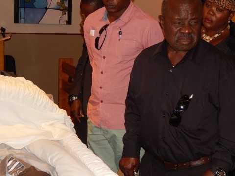 Mr. Willie Nsanda (Senior) breaks down after views his son's body