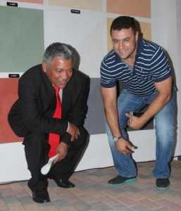 Oriental Director Ahmed Saadi with Minister Given  Lubinda admiring Oriental products.