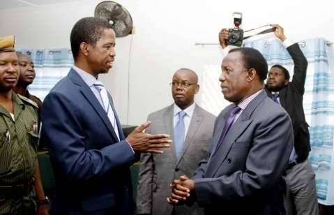 President Edgar Chagwa Lungu speaks with ECZ Commissioner Judge Chulu at Chawama Basic school on March 10,2015, where he witnessed the filling in of nomination papers of Chawama Constituency PF Parliamentary Candidate Lawrence Sichalwe