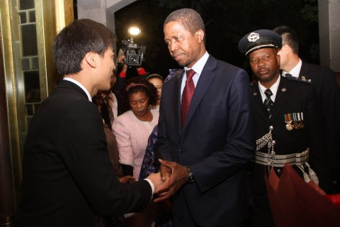 President Edgar Lungu greets Hong Qiao State Guest House's manager of building number two Ivan Lu on arrival at the State Guest House in Shanghai, China on March 26,2015 -Pictures by THOMAS NSAMA