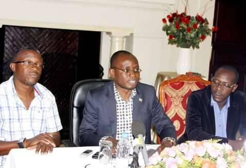 Special Assistant to the President for Press and Public Relations Amos Chanda addresses Journalists at State House. Seated next to him are State House permanent Secretary Emmanuel Chilubanama (l) and Special Assistant to the President for Political affairs Kaiza Zulu (r) on March 9,2015 -Picture by THOMAS NSAMA
