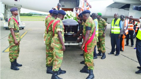 ZAMBIA Army pallbearers prepare to lift late Willie Nsanda's casket from a South African Airways plane at Simon Mwansa Kapwepwe International Airport in Ndola yesterday. Picture by JAMES KUNDA
