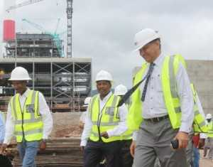 in the middle ZESCO acting MD Victor Mundende and far right  Maamba Colliers CEO Rear Admiral Venkat Shakar (Retd)