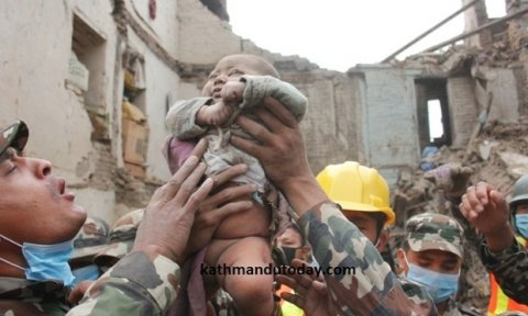 A baby boy was recovered alive from a collapsed building. Photograph: Kathmandu Today