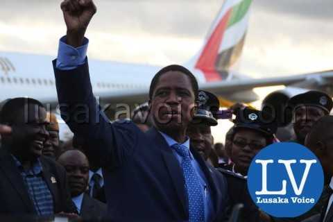 Edgar lungu's Arrival from China, waves fist to supporters at airport - Photo Credit Jean Mandela - Lusakavoice.com