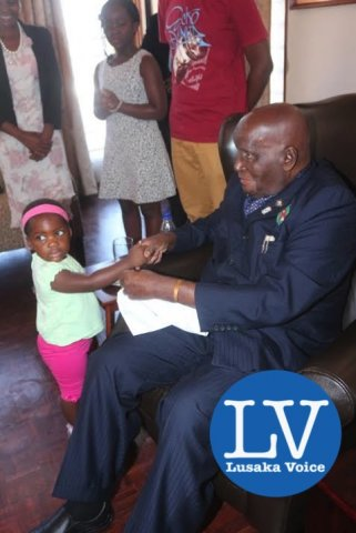 KK with one of his great grand daughters Milika Nyilenda. - Photo Credit Jean Mandela - Lusakavoice.com