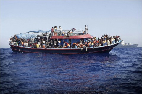 "More than 900 illegal migrants are shipped to the mainland after being rescued by Italian Navy boat ""Fregata Euro"" in the Mediterranean Sea on Sept. 12, 2014. (GIUSEPPE LAMI/EPA)"