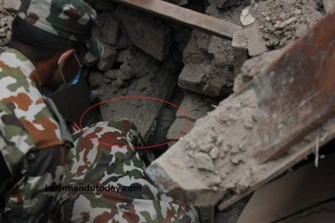 One picture appeared to show the boy, named locally Sonit Awal, four months old, buried deep under rubble and bricks.