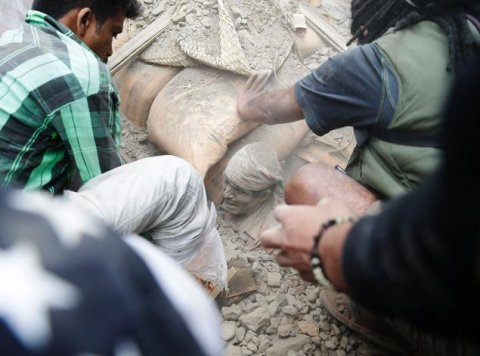 A man is freed from a collapsed building in Kathmandu on Saturday, April 25 following