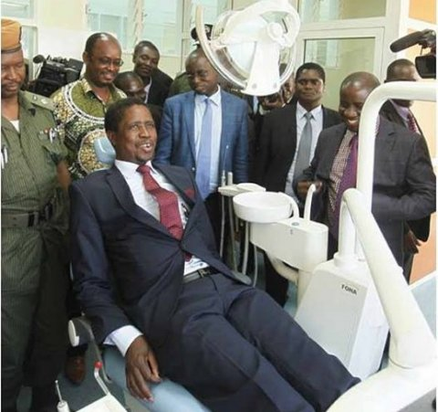 President Edgar Chagwa Lungu having a feel of the Dental Chair during the Commissioning of Michael Chilufya Sata Hospital in Mpika, Muchinga Province on Friday, April 17, 2015. PICTURE BY SALIM HENRY/STATE HOUSE