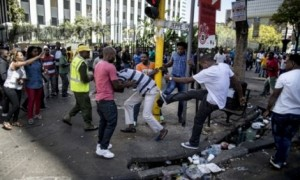 South Africa police fire rubber bullets and teargas on anti-immigrant protest