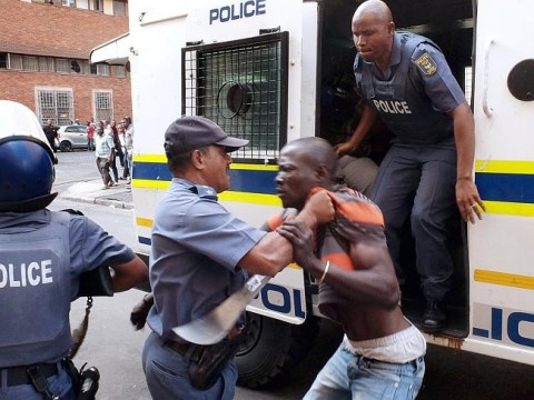 Stand-off continues ... South African Police try to control a protester. Picture- AFP Pho