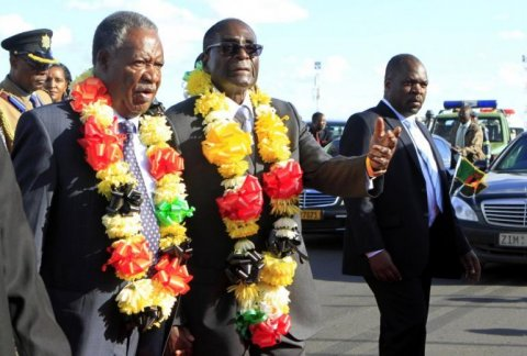 zimbabwe international trade fair-zimbabwe-president robert mugabe walks with zambian president sata - Credit ibtimes.jpg