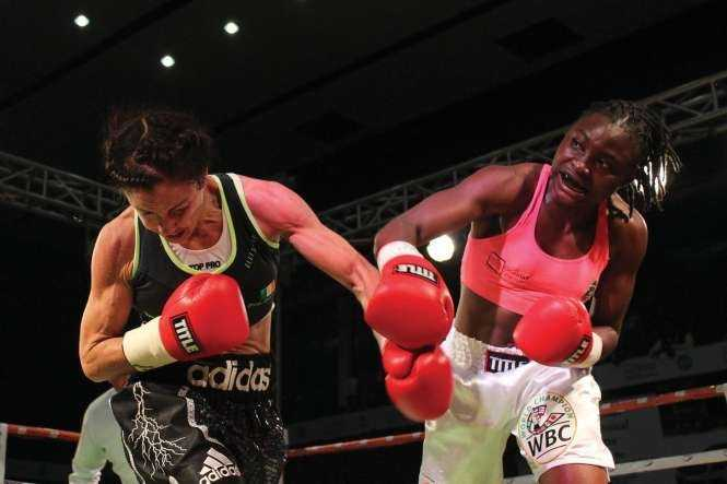 IRISH Christina McMahon in punch for punch with Zambian Catherine Phiri during the Female WBC Gold bout at Mulungushi International Conference Centre in Lusaka on Saturday. PICTURE- CHANDA MWENYA