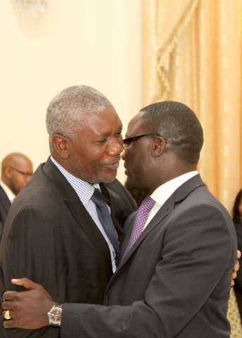 Zambia's Ambassador to France Humphrey Chibanda (r) being congratulated by State House Senior Private Secretary Ogeon Gondwe during the swearing -In-Ceremony at State House on May 4,2015 -Picture by THOMAS NSAMA