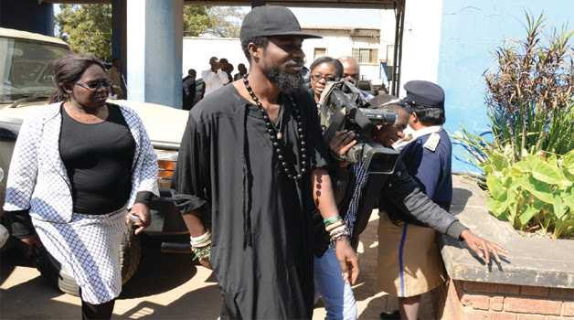 MUSICIAN Chama Fumba, alias Pilato, arriving at Lusaka Central Police yesterday. Picture by CLEVER ZULU