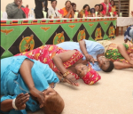 First Lady Esther Lungu, second from left, rolling on the ground thanking people for voting for her husband, President Edgar Lungu, in the January 20 elections. Photo credit - Zambian Watchdog.