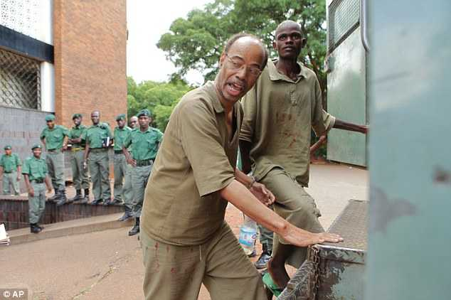 Former US Congressman Mel Reynolds, center left, was arrested in Feb 2014 in Zimbabwe after overstaying his visa. He was later deported to South Africa