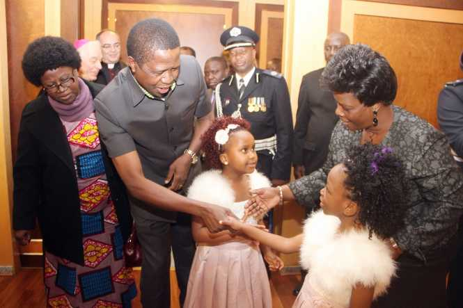 President Lungu greets Nkisu Mashuwa as First Lady Esther Lungu greets Chipengo Mbindawina on arrival at FCO,Flumicino Airport in Rome , Italy on Thursday, February 4,2016 -Picture by THOMAS NSAMA
