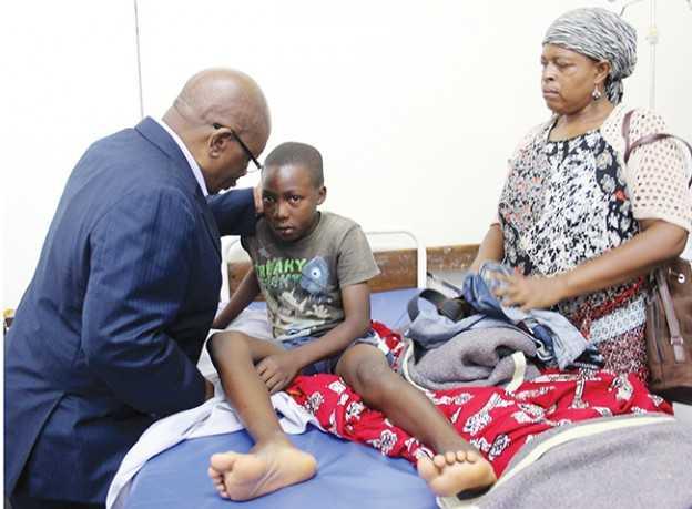 Minister John Phiri with Katuba accident survivor Mwanga Lyombe of Moomba Secondary - Photo Credit Daily Mail