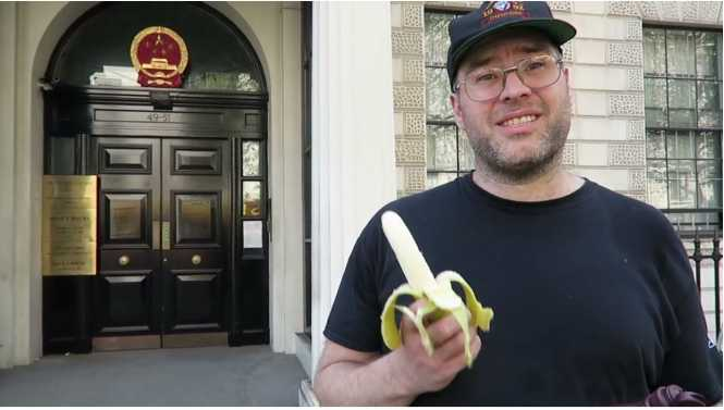 Phil Watson uploaded a video of himself erotically eating a banana outside Chinese Embassy in London
