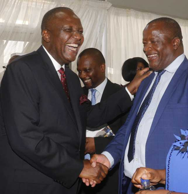 Finance Minister Felix Mutati cracking some jokes with UPND :Legal adviser Jack Mwiimbu.