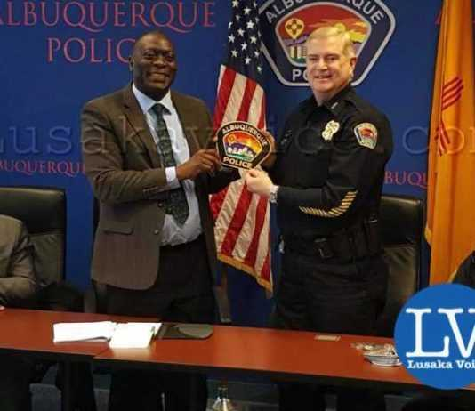 Zambia police Inspector General Kakoma Kangaja with the chief of police of the city of Albuquerque Gorden England. Eden JR