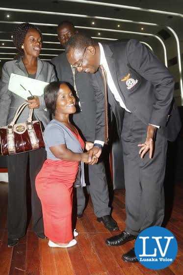 FAZ President Andrew Kamanga talking to Chambishi Angels team manager Norris Hamoonga.