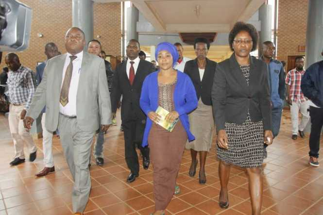 Mutinta (c) arrives at the Lusaka Magistrates' Court this morning in the company of police officers. Picture courtesy of The Mast