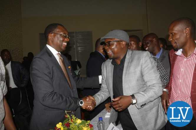 ZANACO FC former player Desmond Mungawa posing with FAZ President Andrew Kamanga.