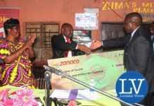 ZANACO Head of Retail Banking, Simon Chuma (c), hands over the Cheque to Minister of Health Dr Chitalu Chilufya, as Kanyama MP Elizabeth Phiri