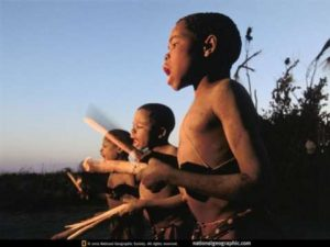Newly circumcised boys greet dawn with traditional song and drumming in Lukulu, Zambia.  PIX- National Geographic