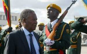 Zambian President Michael Sata inspects the guard of honor in Harare on April 25, 2012. Sata is on a on a two day state visit to Zimbabwe. AFP/PHOTO. Jekesai Njikizana. (Photo credit should read JEKESAI NJIKIZANA/AFP/Getty Images)