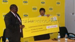 MTN Zambia chief executive officer Abdul Ismail handed over the cheque FAZ acting general secretary Sam Phiri in Lusaka