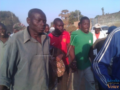 A woman of Lusaka yesterday dumped a baby in a pit latrine and is being held in police custody