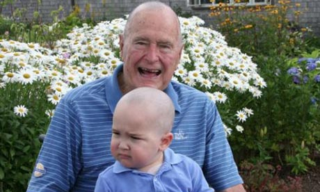 George Bush Sr with Patrick after having his head shaved.