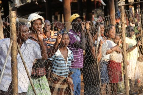 Business came to a stand still as vendors at Chinotimba market watch street carnival proceedings from a fence in Victoria Falls