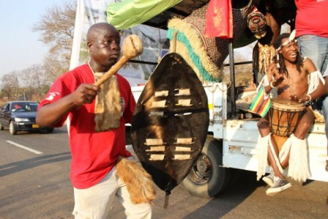 Lovemore Moyo member of the Horn of Africa group perform during a street carnival in Victoria Falls