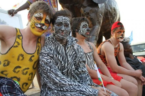 Participants of the Victoria falls street carnival pose for a picture in Chimotimba stadium