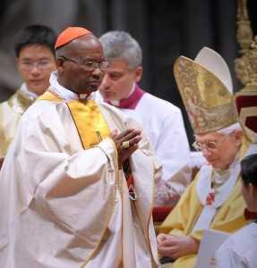Pope Benedict XVI gives his cardinal ring to Cardinal Medardo Joseph Mazombwe.jpg