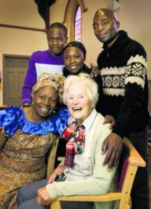 Rosemary Mumbi, front left, with her former teacher Wyn Cornish. Back row, Mike Mwanza, Hellen Cheelo and Chrispin Balashi