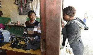 Alice Kalumbu (left) in her tailoring shop in Lusaka. Photograph: Francois d'Elbee