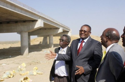 Alexander Chikwanda (right) and former Western Province Permanent Secretary Emmanuel Mwamba inspecting works on the Mongu- Kalabo Road bridge. On the left is Patriotic Front provincial Chairman Kenneth Namutulo