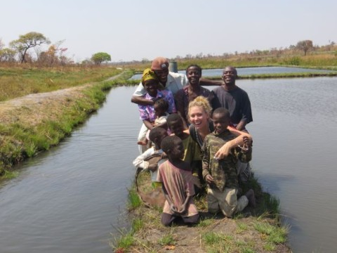 Emily McKeone, a Peace Corps volunteer and University of Nebraska-Lincoln graduate, poses with residents of a rural village in the Luapala province of Zambia. McKeone is raising money to build three wells for three local schools in Zambia.