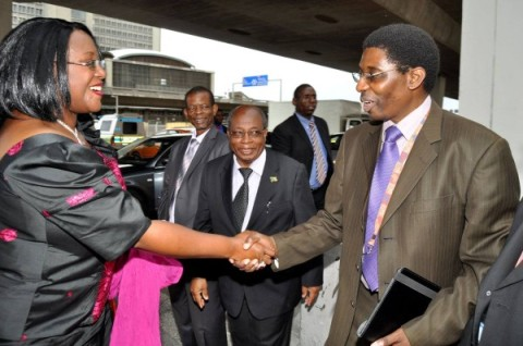 First Lady Dr Christine Kaseba greets Bishop Joshua Banda on arrival at CTICC for the opening of the 17th ICASA Conference at CTICC in Cape Town, South Africa on December 7 2013