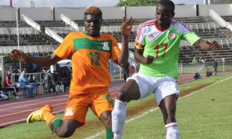 Kabaso Chongo of Zambia (left) battles for the ball with Burundi captain Hasana Hazikimana during a Cecafa Senior Challenge Cup match. Photo:JAMES MAGAYI