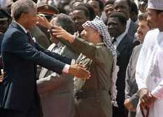 On his first trip to a foreign country after being released from prison, South African anti-apartheid leader and African National Congress (ANC) member Nelson Mandela (l), in Zambia to attend a meeting of the ANC National Executive Committeee, warmly greets PLO chairman Yasser Arafat on his arrival in Lusaka, Feb. 27, 1990. (Philip Littleton/AFP/Getty Images)