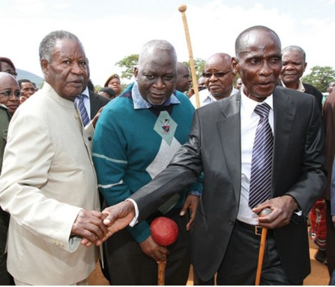 PRESIDENT Sata with Paramount Chief Mpezeni (right), Information permanent secretary George Zulu (middle) and Southern Province Minister Daniel Munkombwe (partly obscured) at Feni yesterday.