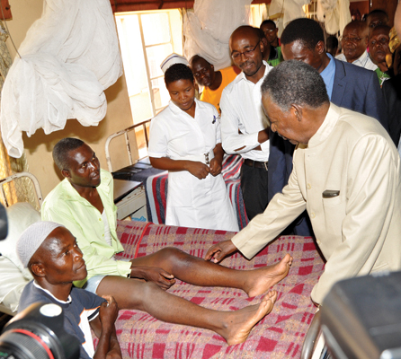 President Sata checks on a patient at Kamoto Hospital in Mambwe District on December 14,2013 -Picture by THOMAS NSAMA